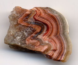 Banded agate. The specimen is one inch (2.5 cm) wide.